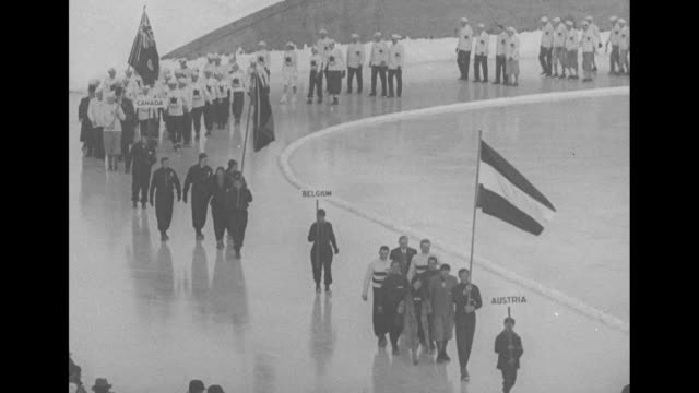 opening ceremony 1932 winter olympics lake placid new york / athletes from 14 countries parade the field with flags and placards of each country us... - 1932 winter olympics lake placid stock videos and b-roll footage