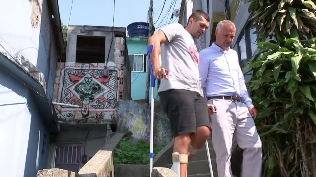 Opening ceremony / lack of investment for facilities for the disabled Rio de Janeiro DAY Various of Rogerio Frajola who fractured his spine in a bus...