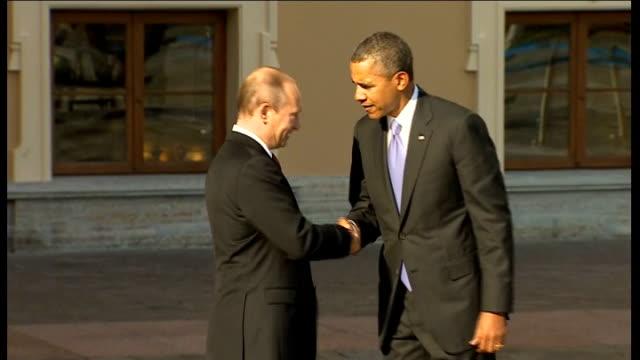 Opening ceremony LIB / St Petersburg Putin greeting Barack Obama