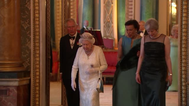 queen elizabeth hopes prince charles will be the next head of the commonwealth england london buckingham palace int queen elizabeth enters banquet... - british empire stock videos & royalty-free footage