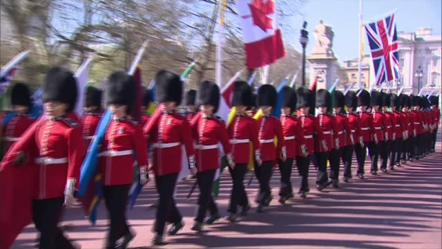 Queen Elizabeth hopes Prince Charles will be the next head of the Commonwealth London EXT Guardsmen march along The Mall carrying Commonwealth flags...