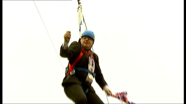 opening ceremony r01081209 / victoria park ext **hemmings interview partly overlaid sot** boris johnson waving two union jack flags and dangling from... - boris johnson stock videos and b-roll footage
