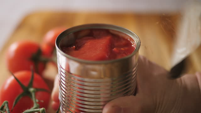 opening chopped tomato tin - raw food stock videos & royalty-free footage