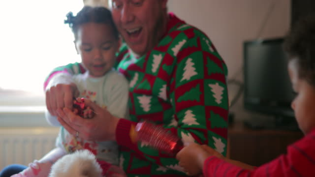 opening christmas cracker with sister - toy stock videos & royalty-free footage