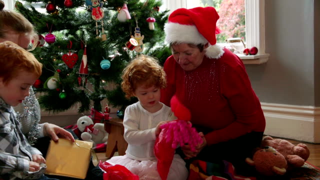 opening christmas presents with grandma - christmas morning stock videos & royalty-free footage