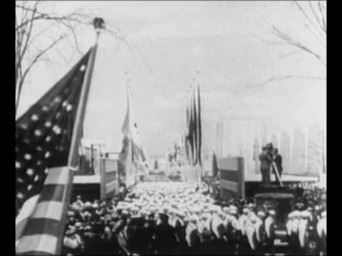 ws opening day parade at the world's fair in new york city / ls crowd marching away from camera us flag passes in foreground / new york world's fair... - world's fair stock videos & royalty-free footage