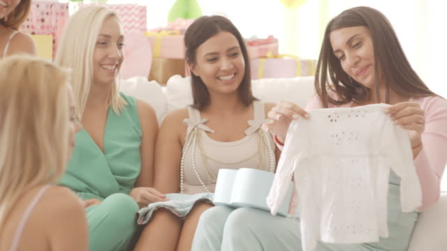 opening gifts on baby shower party - baby shower video stock e b–roll