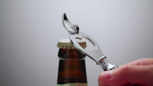 ecu opening of beer cap with bottle opener / seoul, south korea - flasche stock-videos und b-roll-filmmaterial