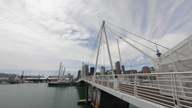 opening pedestrian bridge in viaduct harbour, auckland, new zealand - auckland ferry stock videos & royalty-free footage