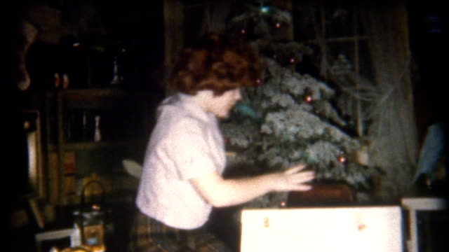opening presents 1950's - christmas tree stock videos & royalty-free footage