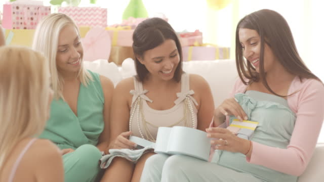 opening presents on baby shower party - baby shower video stock e b–roll