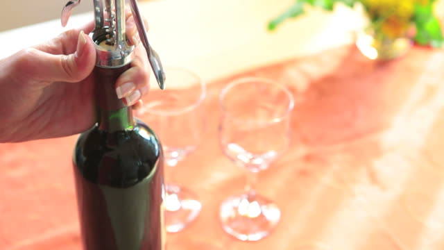 opening red vine - corkscrew stock videos & royalty-free footage