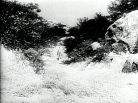 1949 B/W MONTAGE Opening scene from the classic  television series, 'The Lone Ranger' featuring the Lone Ranger (Clayton Moore) riding his horse 'Silver' / AUDIO