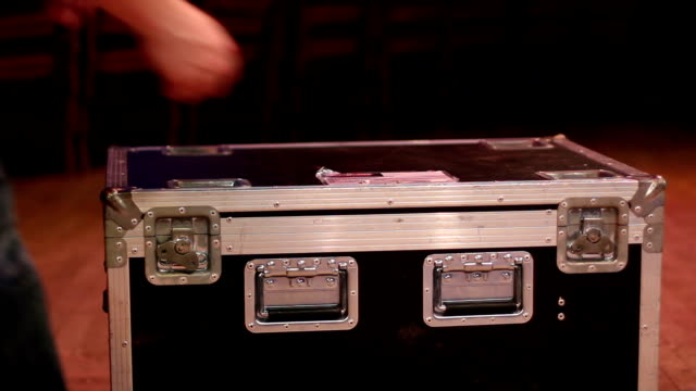Opening up a flight case on stage