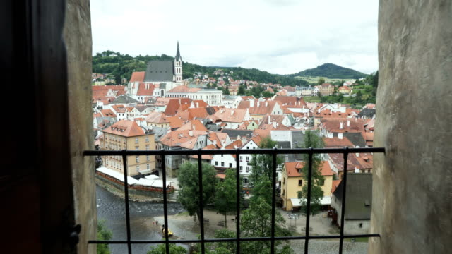 opening view of buildings in Cesky Krumlov town while walking out on balcony
