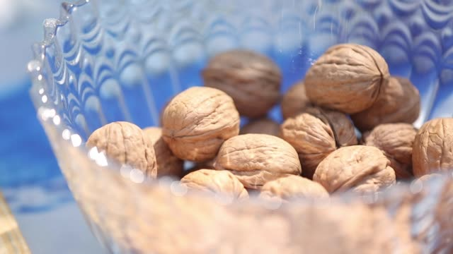 opening walnuts with both hands - nutshell stock videos & royalty-free footage