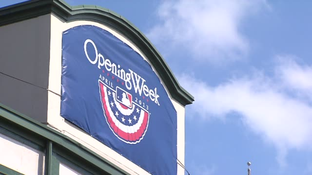 wgn opening week sign outside of wrigley field at wrigley field on april 08 2013 in chicago illinois - 1日目点の映像素材/bロール