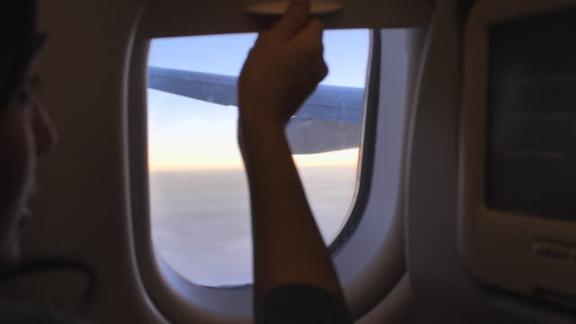 opening window airplane with sunset - open window stock videos and b-roll footage