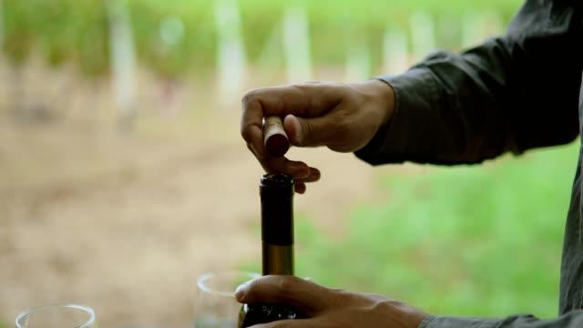 Opening wine bottle