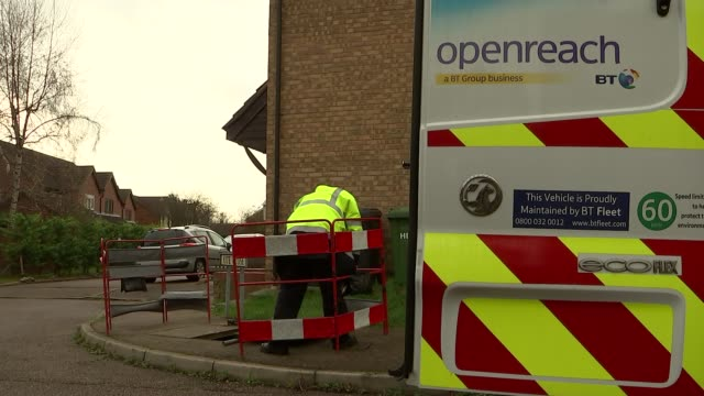 bt openreach engineers installing broadband england cambridgeshire huntingdon hartford openreach engineer unloading roadwork barriers from back of... - cable box stock videos and b-roll footage
