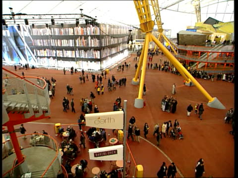opens to the public; itn england: london: greenwich: millennium dome: int roof of millennium dome tilt down large empty space large figure along... - the o2 england stock videos & royalty-free footage