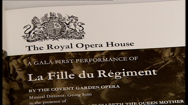 donizetti revival unveils new tenor star **copyrighted audio overlaid sot** souvenir programme of 'la fille du regiment' starring joan sutherland and... - luciano pavarotti stock videos & royalty-free footage