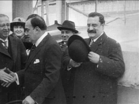 b/w 1909 opera star enrico caruso shaking hands with men smiling / documentary - 1900 1909 stock-videos und b-roll-filmmaterial