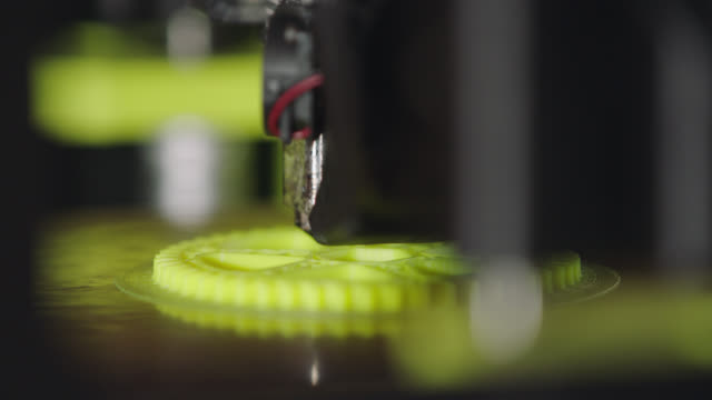 ecu. operating 3d printer manufactures three-dimensional gear with modern technology. - 3d printing stock videos and b-roll footage