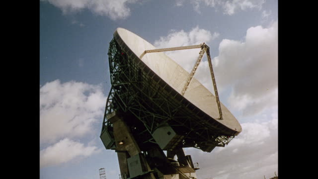 MONTAGE Operating antenna transmissions in control room in Goonhilly Downs / United Kingdom