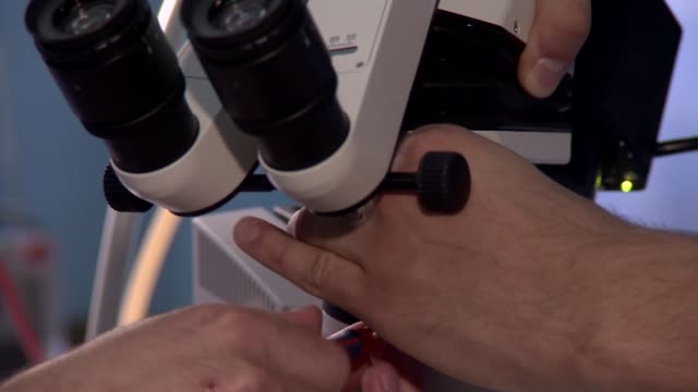 operating microscope - lens optical instrument stock videos & royalty-free footage