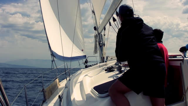 hd: operating sail winch on a yacht - sailor stock videos & royalty-free footage