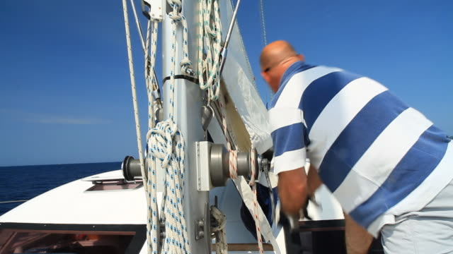hd: operating sail winch on the catamaran - sail stock videos and b-roll footage