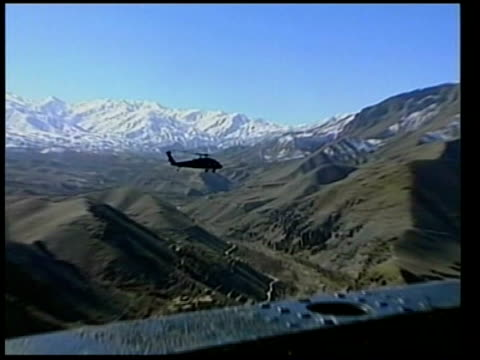 Operation against leading Al Qaida figure ITN Helicopter flying over mountains