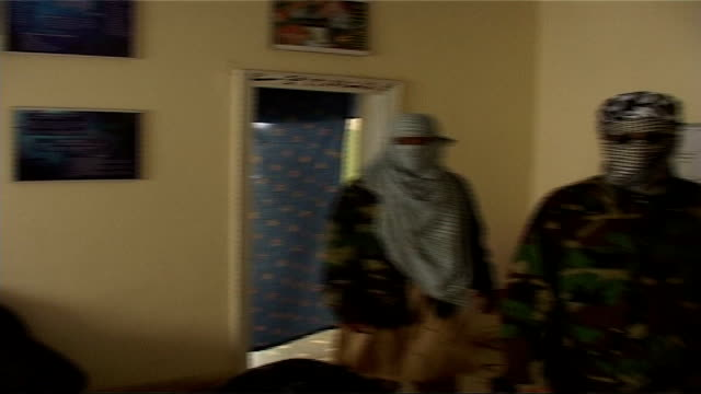 operation crevice/ background tx lahore int kazi rahman also known as abdul salam interview with scarf covering face sot rahman into room with other... - crevice stock videos and b-roll footage