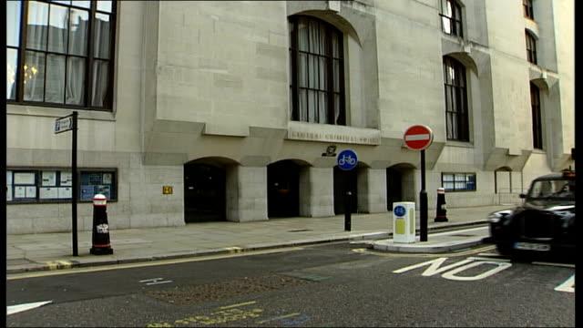 fertiliser bomb trial halted; england: london: close up of central criminal court building sign old bailey building tilt up - crevice stock videos & royalty-free footage