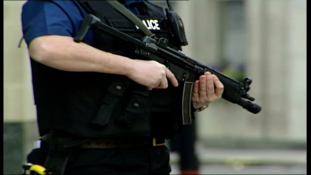trial of seven bomb plot suspects continues armed police officers standing guard outside court machine gun held by policeman police convoy towards as... - crevice stock videos and b-roll footage