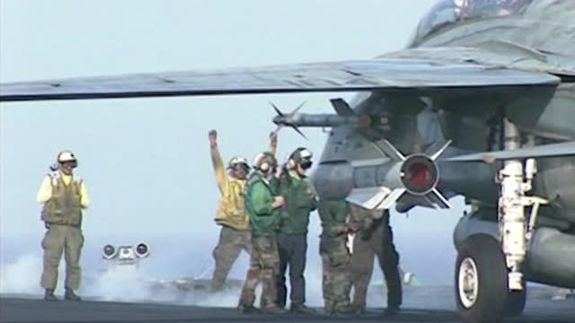 stockvideo's en b-roll-footage met operation enduring freedom - f14's taking off from flight deck of uss enterprise in arabian sea, at start of war in afghanistan against al qaeda in... - september 11 2001 attacks