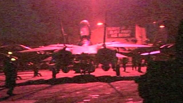 stockvideo's en b-roll-footage met operation enduring freedom - night footage of f14 tomcat takes off from uss enterprise in arabian sea at start of war against al qaeda in afghanistan... - september 11 2001 attacks