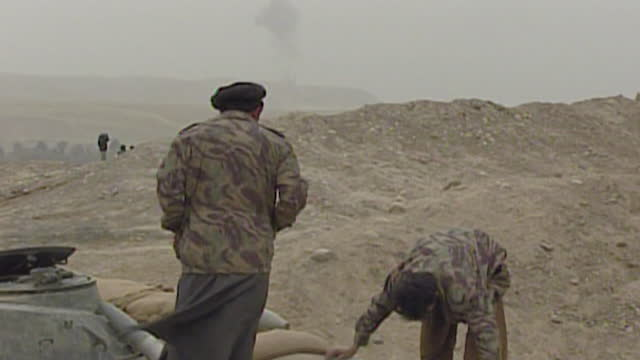 operation enduring freedom - northern alliance soldiers watch as us fighter jets bomb taliban frontline on the northern border of afghanistan in war... - fighter stock videos & royalty-free footage
