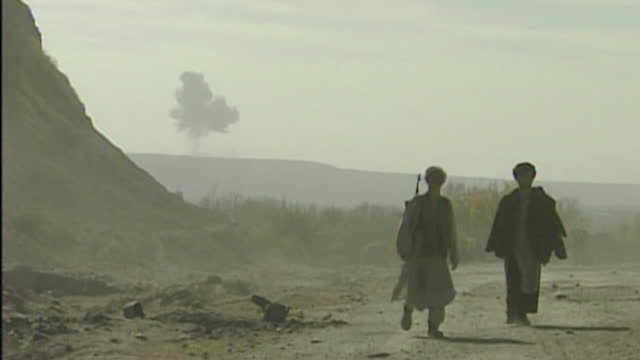 operation enduring freedom - northern alliance soldiers watch on as us b52 bombers, bomb taliban frontline in kunduz, during war on terror in... - september 11 2001 attacks stock-videos und b-roll-filmmaterial