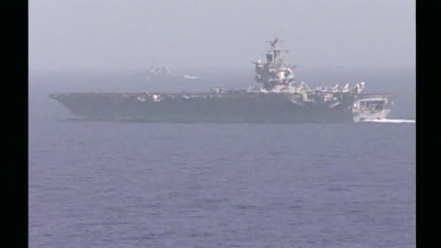 stockvideo's en b-roll-footage met operation enduring freedom - uss enterprise aircraft carrier in arabian sea at start of war against in al qaeda and osama bin laden in the aftermath... - september 11 2001 attacks