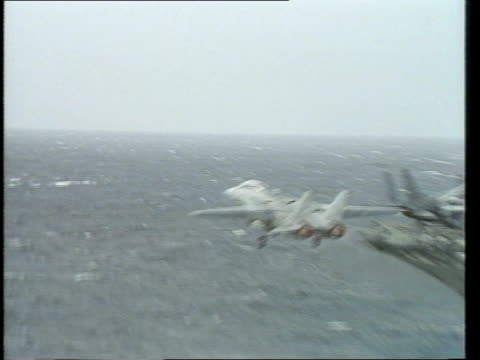 america at sea a/s more ditto a/s f14 tom cat taking off from uss america deck pan rl tom cat in flight a/s grumman intruder a6 taking off from uss... - grumman f 14 stock videos and b-roll footage