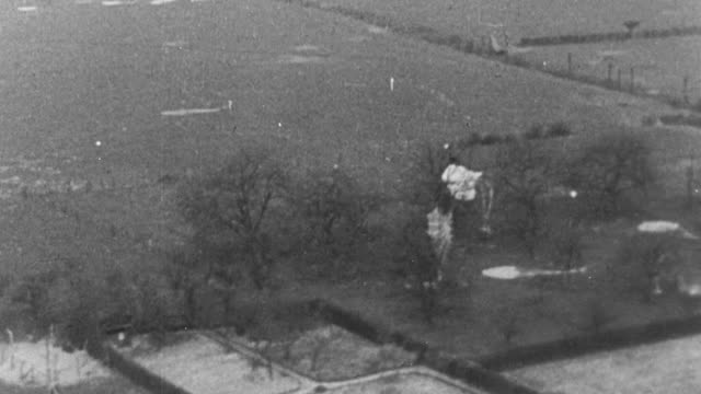 montage operation varsity on march 24, 1945, with towing bombers releasing gliders over the rhine river, one glider crashing on landing, with pilot and copilot injured and debris scattered across the ground / germany - 1945 stock videos and b-roll footage