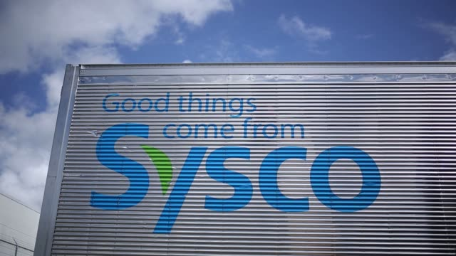 Operations at a at Sysco Corp distribution center in Concord North Carolina US on Wednesday Aug 10 Shots full shot of Sysco logo on wall above bushes...