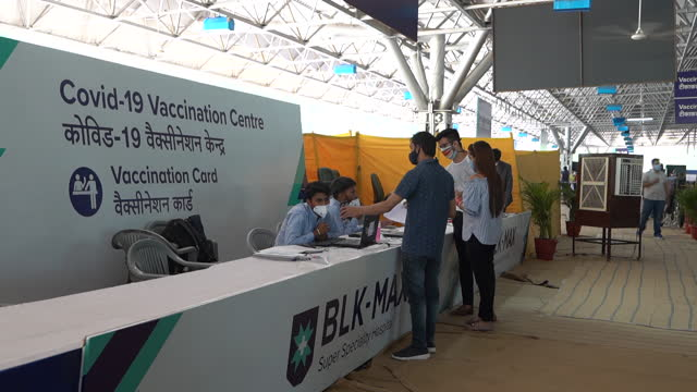 operations at a covid-19 vaccination center set up at the blk super speciality hospital in new delhi, india, on friday, may 21, 2021. in india, daily... - human arm stock videos & royalty-free footage