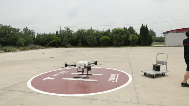 operations at a jdcom drone delivery site on the outskirts of xi'an china on tuesday june 19 2018 - helicopter landing pads stock videos and b-roll footage