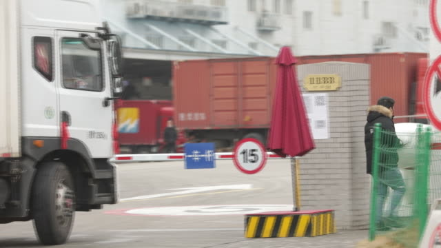 operations at a local jdcom warehouse and its asia one shanghai jiading logistics center in shanghai china on saturday february 29 2020 - boom barrier stock videos & royalty-free footage