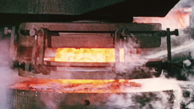 MONTAGE Operations at a steel foundry and manufacturing plant, with molten and glowing hot iron and steel moving along automated production lines / Wales, United Kingdom
