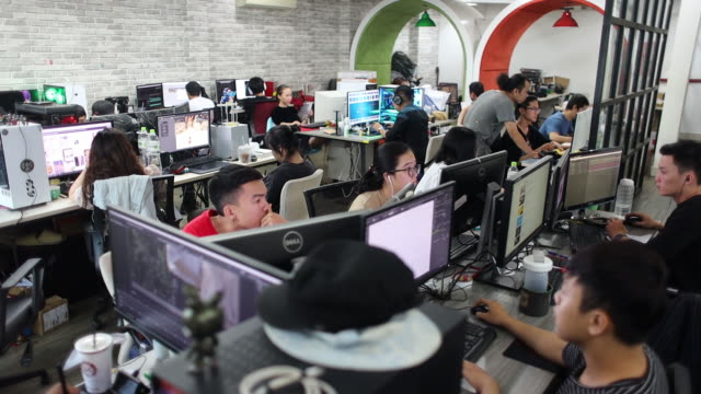 operations at a yeah1 group studio in ho chi minh vietnam on monday march 4 2019 yeah1 operates multichannel media networks serving customers in asia... - using laptop stock videos & royalty-free footage