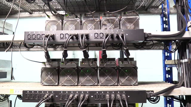 stockvideo's en b-roll-footage met operations at canada computational unlimited inc. computation center in joliette, quebec, canada, on friday, sept. 10, 2021. ccu.ai, a bitcoin mining... - mining